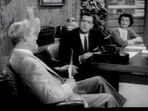 Amplicall on Perry Mason's desk